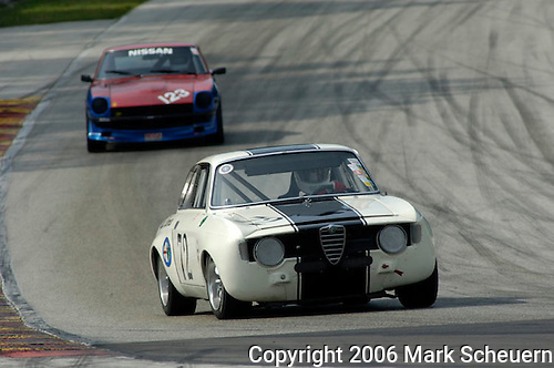 Peter Conklin and his 1967 Alfa Romeo GTV in turn 5 at the Kohler International Challenge with Brian Redman, 2006<br /> <br /> Please contact me for full-size images.<br /> <br /> For non-editorial usage, releases are the responsibility of the licensee.