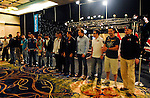 Team Pokerstars Pros line up in front of the tournament area.