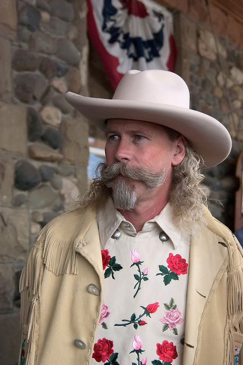 WY: Wyoming, Cody: Buffalo Bill impersonator...Photo #: yellow506..Photo copyright Lee Foster, 510/549-2202, lee@fostertravel.com, www.fostertravel.com..