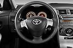 Steering wheel view of a 2010 Toyota Corolla Linea Sol 4 Door Sedan