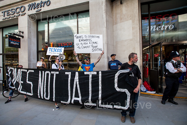 &quot;Homes Not Jails&quot; Demo.<br /> <br /> London, 12/06/2014. Today, two separate activist groups, the &quot;Left Unity&quot; and &quot;Homes Not Jails&quot; held demonstrations outside the Tesco Metro in Regent Street to protest against the metal studs - 'spikes' - that had been installed to prevent rough sleepers. The spikes, cemented overnight by another group of activists, the LBR (London Black Revs/Revolutionaries), had already been removed by Tesco before the demonstrations of today.