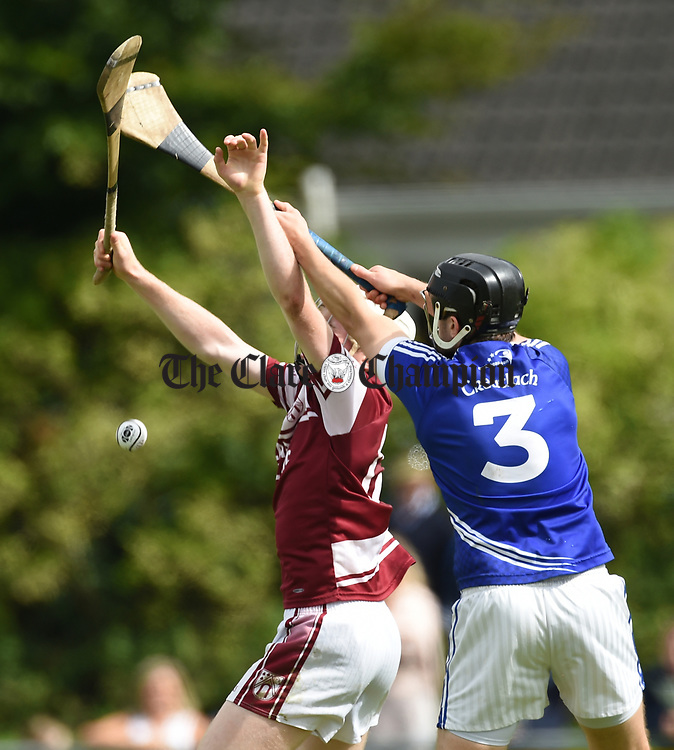 Tom Hannon of St Joseph's Doora Barefield in action against Micheal Hawes of Cratloe during their round three senior championship game in Sixmilebridge. Photograph by John Kelly