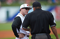 Louisville Cardinals head coach Dan McDonnell talks with home plate umpire David Savage during the game against the Florida State Seminoles in Game Eleven of the 2017 ACC Baseball Championship at Louisville Slugger Field on May 26, 2017 in Louisville, Kentucky. The Seminoles defeated the Cardinals 6-2. (Brian Westerholt/Four Seam Images)