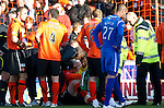 Dundee Utd v St Johnstone...25.09.10  .Garry Kenneth is treated for a bad head knock.Picture by Graeme Hart..Copyright Perthshire Picture Agency.Tel: 01738 623350  Mobile: 07990 594431