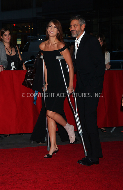 WWW.ACEPIXS.COM . . . . . ....September 24 2007,  New York City....Actor George Clooney (R) and his girlfriend Sarah Larson, nursing a broken foot, arriving at the 'Michael Clayton' premiere at The Ziegfeld Theatre. Clooney and Larson were both injured in a motorcycle accident in New Jersey on September 21 2007.......Please byline: KRISTIN CALLAHAN - ACEPIXS.COM.. . . . . . ..Ace Pictures, Inc:  ..(646) 769 0430..e-mail: info@acepixs.com..web: http://www.acepixs.com