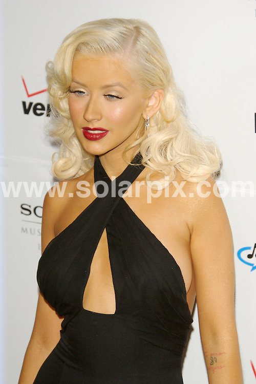 **ALL ROUND PICTURES FROM SOLARPIX.COM**.**SYNDICATION RIGHTS FOR UK, S.AFRICA, DUBAI, AUS**.Christina Aguilera - 2007 Clive Davis Pre-Grammy Awards Party - Beverly Hilton Hotel - Beverly Hills - 10.02.07...JOB REF:   3345  PHZ    DATE: 10.02.07.**MUST CREDIT SOLARPIX.COM OR DOUBLE FEE WILL BE CHARGED**
