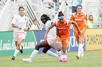 Natasha Kai #6 goes past Tina Ellertson...Saint Louis Athletica defeated Sky Blue FC 1-0 at Anheuser-Busch Soccer Park, Saint Louis, MO.