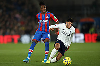 23rd November 2019; Selhurst Park, London, England; English Premier League Football, Crystal Palace versus Liverpool; Alex Oxlade-Chamberlain of Liverpool takes on Wilfried Zaha of Crystal Palace - Strictly Editorial Use Only. No use with unauthorized audio, video, data, fixture lists, club/league logos or 'live' services. Online in-match use limited to 120 images, no video emulation. No use in betting, games or single club/league/player publications