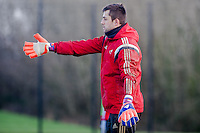 SWANSEA, WALES - JANUARY 28:  Lukasz Fabianski of Swansea City gestures to team mates during training  on January 28, 2015 in Swansea, Wales.