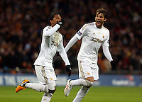Pictured L-R: Jonathan de Guzman of Swansea celebrating his goal with a penalty kick with team mate Michu. Sunday 24 February 2013<br /> Re: Capital One Cup football final, Swansea v Bradford at the Wembley Stadium in London.