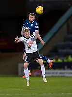 10th March 2020; Dens Park, Dundee, Scotland; Scottish Championship Football, Dundee FC versus Ayr United; Christie Elliott of Dundee competes in the air with Scott Tiffoney of Ayr United