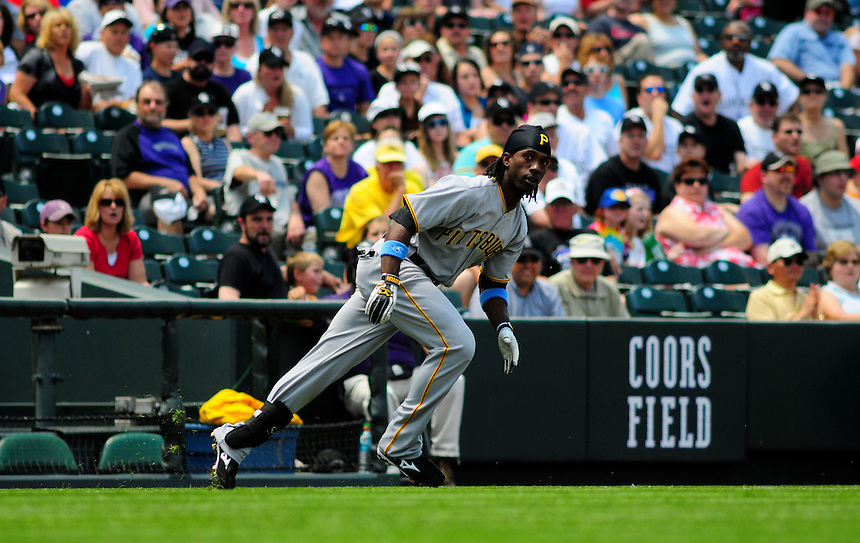 June 21, 2009: Pirates outfielder Andrew McCutchen hits a leadoff triple during a game between the Pittsburgh Pirates and the Colorado Rockies at Coors Field in Denver, Colorado. The Rockies beat the Pirates 5-4, to improve to 16-1 in the last 17 games.