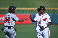 Mesa Solar Sox outfielder Victor Robles (14), of the Washington Nationals organization, talks to Ronald Acuna (34), of the Atlanta Braves organization, before an Arizona Fall League game against the Peoria Javelinas on October 25, 2017 at Sloan Park in Mesa, Arizona. The Solar Sox defeated the Javelinas 6-3. (Zachary Lucy/Four Seam Images)