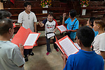 Deaconess Irene Lagahit Vioya leads a choir of street people as they practice singing before worship at Knox United Methodist Church in Manila, Philippines. A graduate of Harris Memorial College, she is on the staff of Knox.
