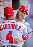 26 September 2018: Washington Nationals outfielder Bryce Harper gets a hug from Manager Dave Martinez prior to a game against the Miami Marlins at Nationals Park in Washington, DC. The Nationals defeated the visiting Marlins 9-3, closing out Washington's 2018 home season. Mandatory Credit: Ed Wolfstein Photo *** RAW (NEF) Image File Available ***