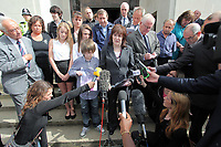 Pictured: Sonia Oatley (C) mother of tragic teen Rebecca Aylward with her young son Jack (L) reading a statement outside Swansea Crown Court. Friday 02 September 2011<br /> Re: A 16-year-old boy who battered his former girlfriend to death has been sentenced to a minimum of fourteen years in prison by a judge at Swansea Crown court today (Fri 02 September 2011) for her murder.<br /> Rebecca Aylward, 15, from Maesteg, was lured into a wood in Aberkenfig, near Bridgend, in October 2010. <br /> Joshua Davies denied murder, blaming his friend, but was convicted by a 10-2 majority verdict in July.