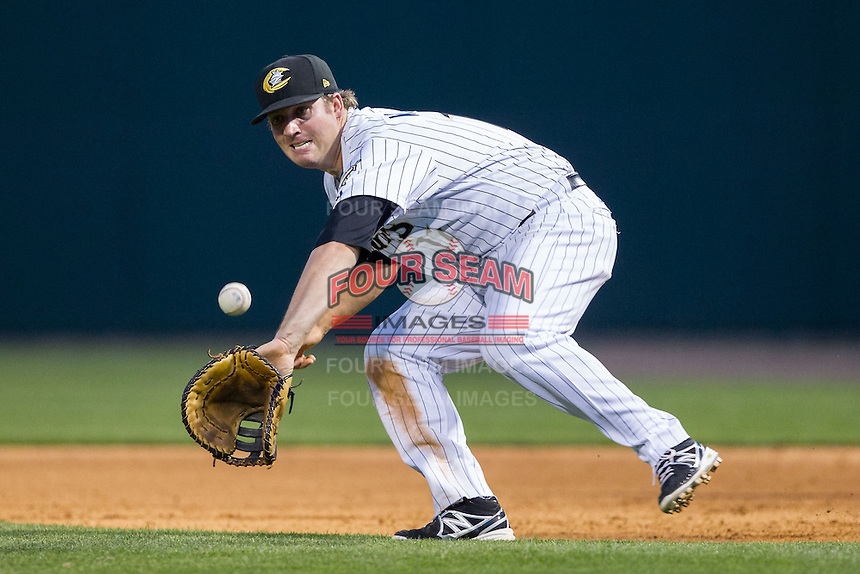Charlotte Knights first baseman Andy Wilkins (17) fields a ground ball against the Lehigh Valley IronPigs at BB&T Ballpark on May 8, 2014 in Charlotte, North Carolina.  The IronPigs defeated the Knights 8-6.  (Brian Westerholt/Four Seam Images)