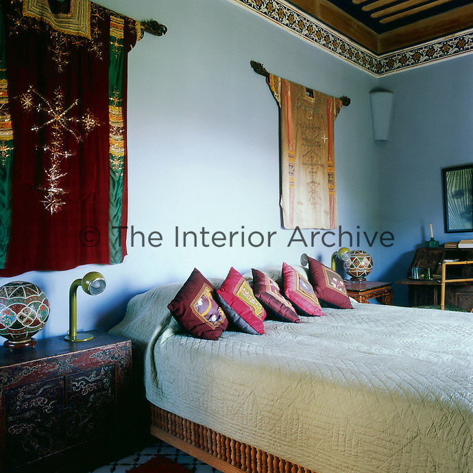In the blue bedroom the walls are adorned with two sumptuous Yemeni robes and an Afghan hanging. There is furniture from Mongolia and Nuristan. The bathroom is of ivory tadelakt.