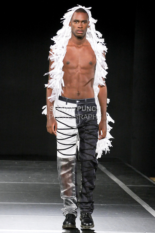 Model walks the runway in an outfit Cristina Nitopi for the Cristina Nitopi Mens Spring 2011 Saint Michael Collection, during Couture Fashion Week, September 12, 2010.