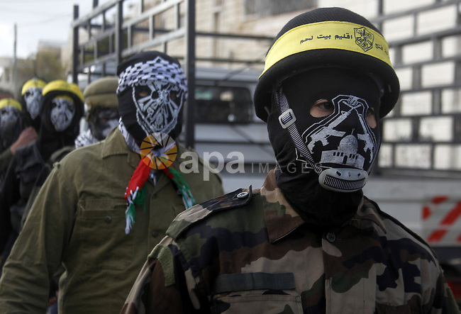 Masked Palestinians march during the funeral of Ali Taqatqa and Ali Thawabteh, who the Israeli military said were shot dead by Israeli troops after they stabbed and wounded an Israeli soldier on Thursday outside a Jewish settlement, in the West Bank village of Beit Fajjar, south of Bethlehem March 20, 2016. Photo by Wisam Hashlamoun
