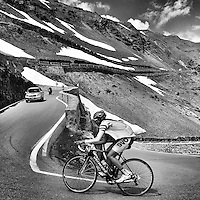 Ascending the 48 switchbacks of the western approach of the Passo dello Stelvio, above the town of Prato dello Stelvio, Italy.
