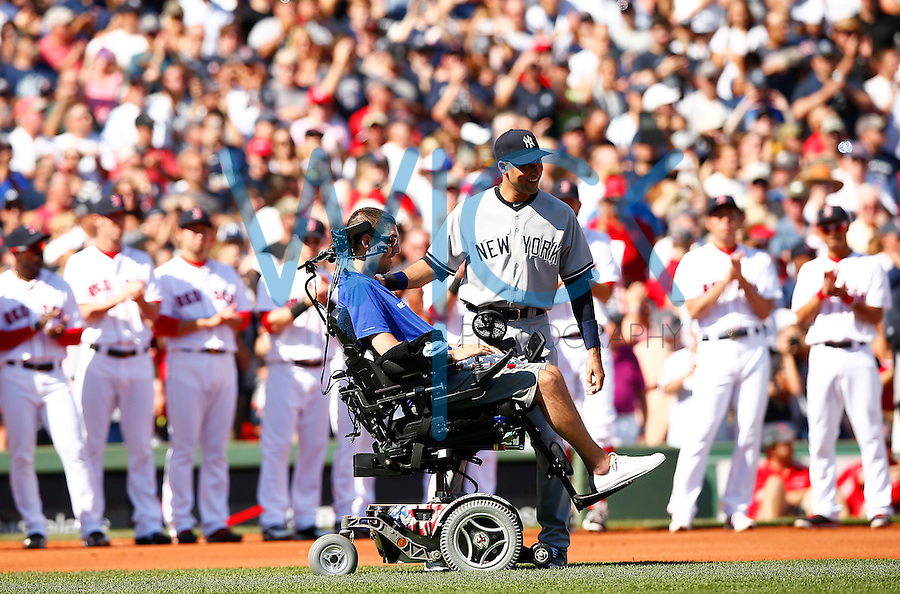 Derek Jeter #2 of the New York Yankees is greeted by Pete Frates, the man who started the ALS ice bucket challenge, during pregame ceremonies prior to the game against the Boston Red Sox at Fenway Park in Jeter's final career game on September 27, 2014 in Boston, Massachusetts. (Photo by Jared Wickerham for the New York Daily News)