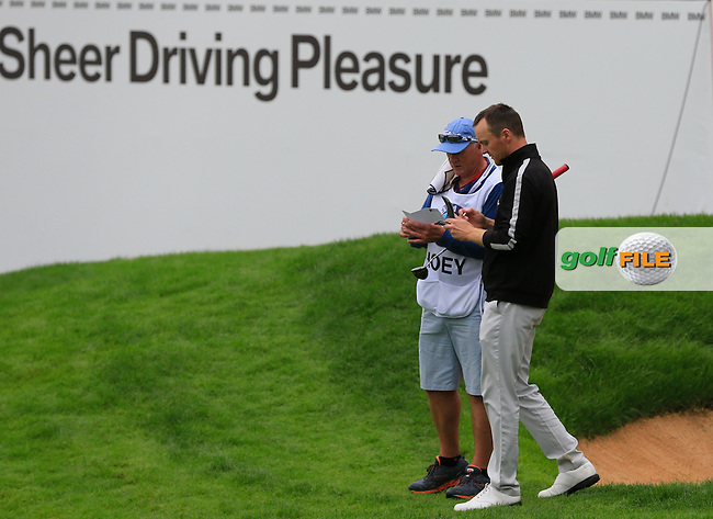 Michael Hoey (NIR) and caddy Gerry on the 18th green during Saturay's Round 3 of the 2014 BMW Masters held at Lake Malaren, Shanghai, China. 1st November 2014.<br /> Picture: Eoin Clarke www.golffile.ie