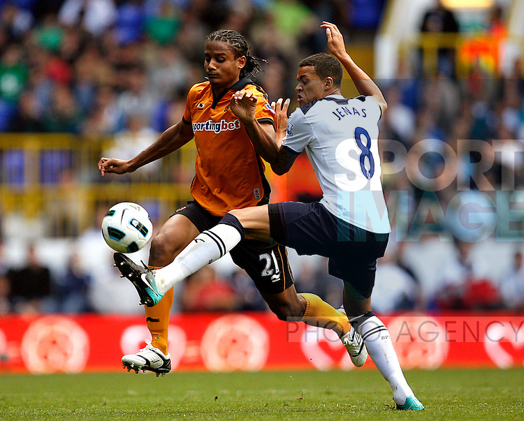 Michael Mancienne of Wolverhampton Wanderers is tackled by Jermaine Jenas of Tottenham Hotspur