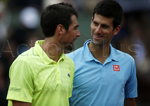 28.05.2014. Roland garros, Paris, France. French Open tennis tournament. Novak Djokovic of Serbia (R) commiserates with Jeremy Chardy of France after their mens singles match