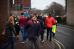 Home fans making their way towards the stadium before Burnley hosted Everton in an English Premier League fixture at Turf Moor. Founded in 1882, Burnley played their first match at the ground on 17 February 1883 and it has been their home ever since. The visitors won the match 5-1, watched by a crowd of 21,484.