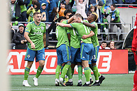 SEATTLE, WA - NOVEMBER 10: Kelvin Leerdam #18 of the Seattle Sounders FC is mobbed by teammates including Jordan Morris #13, Raul Ruidiaz #9, Brad Smith #11, and Joevin Jones #33 after scoring the game's first goal during a game between Toronto FC and Seattle Sounders FC at CenturyLink Field on November 10, 2019 in Seattle, Washington.