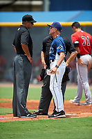 GCL Rays coach Jim Morrison (2) argues with first base umpire Thomas O'Neil while home plate umpire Cord Coslor listens in during the first game of a doubleheader against the GCL Twins on July 18, 2017 at Charlotte Sports Park in Port Charlotte, Florida.  GCL Twins defeated the GCL Rays 11-5 in a continuation of a game that was suspended on July 17th at CenturyLink Sports Complex in Fort Myers, Florida due to inclement weather.  (Mike Janes/Four Seam Images)
