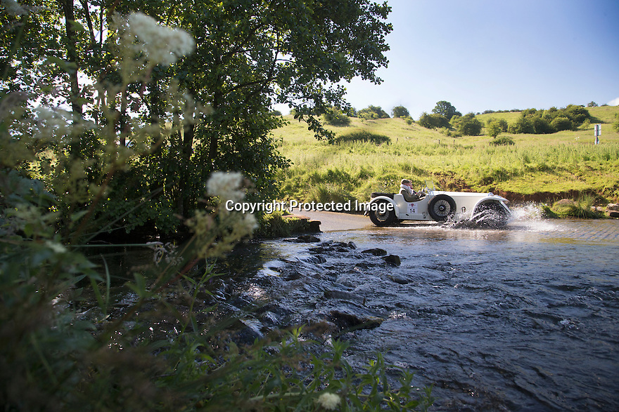 14/06/16<br /> <br /> A 1931 Invictor S Type Low Chassis. <br /> <br /> Competitors in the Royal Automobile Club 1000 Mile Trial splash through Tissington Ford near Ashbourne in the Derbyshire Peak District. The rally saw 43 pre-war cars leave Edinburgh on Monday and finishes in Dorking, Surrey on Saturday.<br /> All Rights Reserved, F Stop Press Ltd.