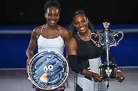 January 28, 2017: Serena Williams of United States pose for photos with her sister Venus Williams after winning the Women's Final on day 13 of the 2017 Australian Open Grand Slam tennis tournament in Melbourne, Australia. Photo Sydney Low