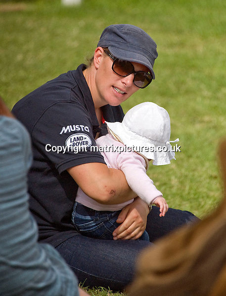 NON EXCLUSIVE PICTURE: MATRIXPICTURES.CO.UK<br /> PLEASE CREDIT ALL USES<br /> <br /> WORLD RIGHTS<br /> <br /> British royal and equestrian rider Zara Phillips is pictured with baby Mia at the St. James's Place Wealth Management Barbury International Horse Trials near Swindon.<br /> <br /> JULY 5th 2014<br /> <br /> REF: RWN 143192