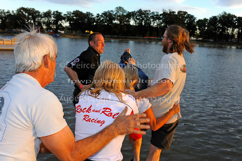 The Fairchild Brothers and the Reno's prepare to toss Tammy Wolfe-Jakob into the river.