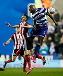 Ben Osborn of Sheffield Utd challenges Yakou Meite of Reading during the FA Cup match at the Madejski Stadium, Reading. Picture date: 3rd March 2020. Picture credit should read: Simon Bellis/Sportimage
