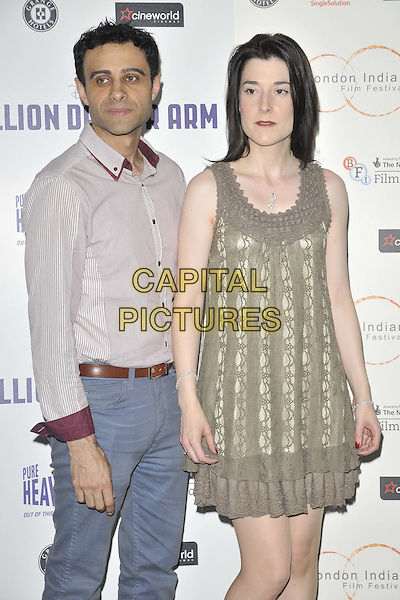 LONDON, ENGLAND - JULY 14: Rez Kempton &amp; guest attend the London Indian Film Festival &quot;Million Dollar Arm&quot; UK film premiere, Cineworld Shaftesbury Avenue cinema, Coventry St., on Monday July 14, 2014 in London, England, UK. <br /> CAP/CAN<br /> &copy;Can Nguyen/Capital Pictures