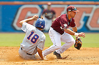 June 11, 2011:   Florida Gators outfielder Tyler Thompson (18) slides in safely into second base under the tag of Mississippi State Bulldogs inf Jonathan Ogden (3) during NCAA Gainesville Super Regional Game 2 action between Florida Gators and Mississippi State Bulldogs played at Alfred A. McKethan Stadium on the campus of Florida University in Gainesville, Florida.   Mississippi State defeated Florida 4-3.........