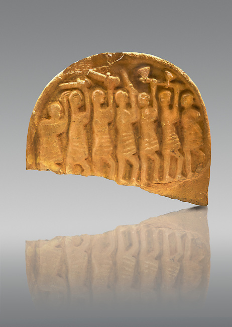 The Viking Raiders Stone depicting men holding swords and axes above their heads. The shape of the axes suggest they are Viking raiders. Anglo Saxon probably carved as a memorial of the first Viking Raind on Lindisfarne Island in 793. Lindisfarne Abbey Museum, Northumbria, England