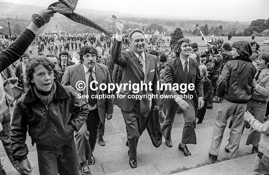 UWC Strike victory rally at Parliament Buildings, Stormont, Saturday, 1st June 1974. William Craig, leader of the Vanguard Unionist Party, is in the middle, with Andy Tyrie, UDA leader Andy Tyrie on the left, and strike committee chairman Glen Barr on the right. Reverend Ian Paisley is behind Craig and Barr. 197406010331e<br />