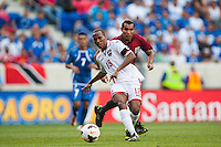 Trinidad and Tobago midfielder Denzil Theobald (18) passes the ball during a CONCACAF Gold Cup group B match at Red Bull Arena in Harrison, NJ, on July 8, 2013.
