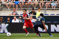 Eric Avila (8) of Toronto FC is marked by Sheanon Williams (25) of the Philadelphia Union. The Philadelphia Union defeated Toronto FC 3-0 during a Major League Soccer (MLS) match at PPL Park in Chester, PA, on July 8, 2012.