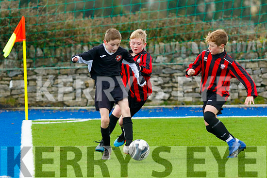 Pierce Lowth, Tralee Dynamos, gets himself out of a corner as Conor Hayes&Conor Shanahan, Holy Cross Limerick close in, during the U13 National Cup match between the sides  played at the KDL, Tralee last Saturday afternoon.