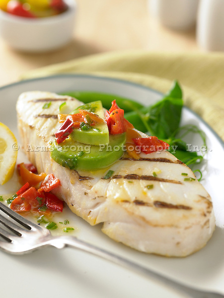 Grilled halibut steak with avocado, red pepper
