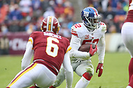 Landover, MD - December 9, 2018: New York Giants outside linebacker Alec Ogletree (52) intercepts a pass during the  game between New York Giants and Washington Redskins at FedEx Field in Landover, MD.   (Photo by Elliott Brown/Media Images International)