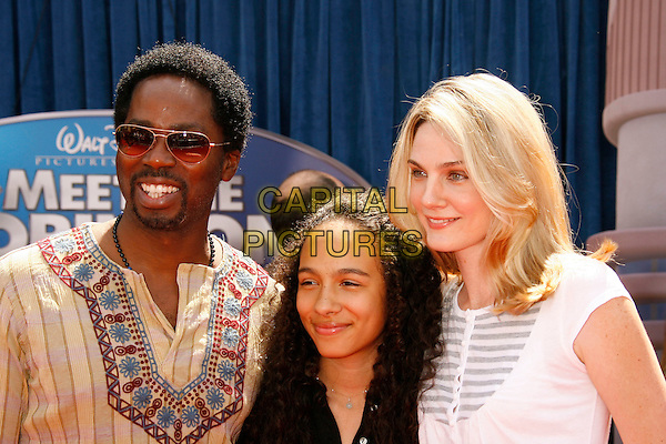 """HAROLD PERRINEAU, wife BRITTANY & daughter AURORA.Attending the """"Meet The Robinsons"""" Los Angeles Premiere held at the El Capitan Theatre, Hollywood, California, USA, 25 March 2007..half length family married husband wife.CAP/ADM/RE.©Russ Elliot/AdMedia/Capital Pictures."""