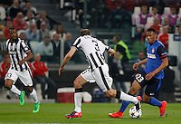 Calcio, quarti di finale di andata di Champions League: Juventus vs Monaco. Torino, Juventus stadium, 14 aprile 2015.<br /> Monaco's Anthony Martial, right, is challenged by Juventus' Giorgio Chiellini, center, during the Champions League quarterfinals first leg football match between Juventus and Monaco at Juventus stadium, 14 April 2015.<br /> UPDATE IMAGES PRESS/Isabella Bonotto