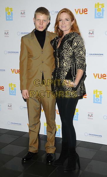 Charlie Palmer-Merkle &amp; Patsy Palmer<br /> The &quot;It's A Lot&quot; UK film premiere, Vue West End cinema, Leicester Square, London, England.<br /> October 21st, 2013<br /> full length black top beige brown suit pattern metallic jacket leggings  clutch bag gold<br /> CAP/CAN<br /> &copy;Can Nguyen/Capital Pictures