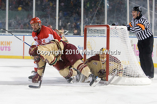 Luke Popko (BU - 26), Cam Atkinson (BC - 13), John Muse (BC - 1) - The Boston University Terriers defeated the Boston College Eagles 3-2 on Friday, January 8, 2010, at Fenway Park in Boston, Massachusetts, as part of the Sun Life Frozen Fenway doubleheader.